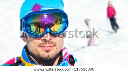 Clouseup portrait of young man with ski goggles in the Zillertal Arena, Austria - stock photo