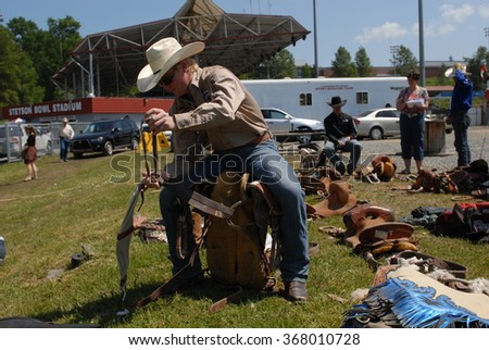 CLOVERDALE, CANADA - MAY 19, 2012: Cowboys are getting ready to compete in the annual Cloverdale Rodeo on May 19, 2012 in Cloverdale, BC, Canada.