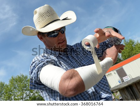 CLOVERDALE, CANADA - MAY 19, 2012: Cowboys are getting ready to compete in the annual Cloverdale Rodeo on May 19, 2012 in Cloverdale, BC, Canada. - stock photo