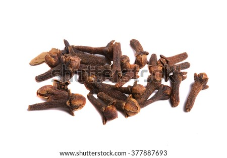 Cloves dried is scattered on a white background, isolation