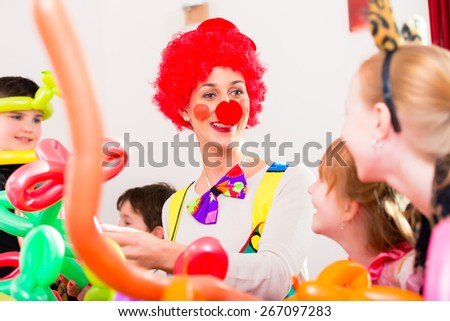 Clown at children birthday party entertaining the kids