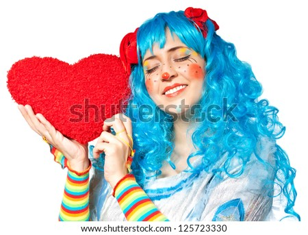 Clown girl holding heart. Isolated on white - stock photo