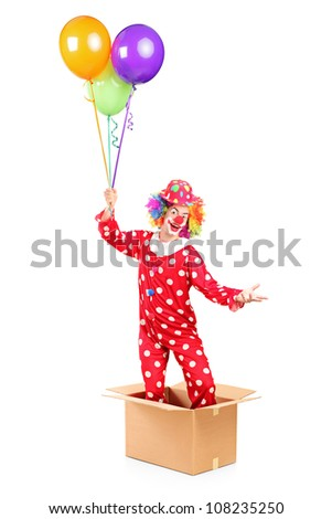 Clown holding balloons and standing in a cardboard box, isolated on white background - stock photo