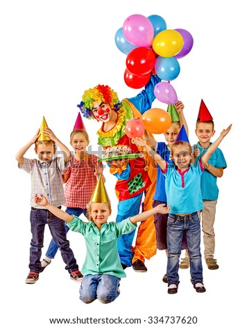 Clown holding cake and balloons on birthday with group children. Isolated. - stock photo