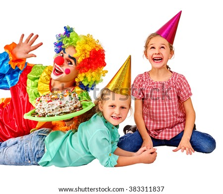 Clown keeps cake on birthday with two children. Isolated.