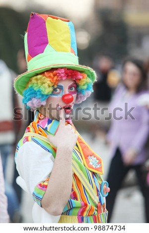 Clown posing for picture in the street - stock photo