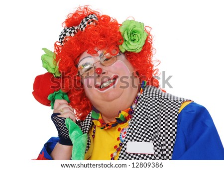 Clown posing with rose isolated over a white background