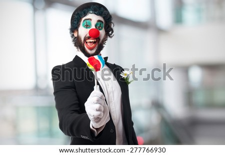 clown with a lolly pop - stock photo