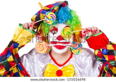Clown with lollipops isolated on white - stock photo