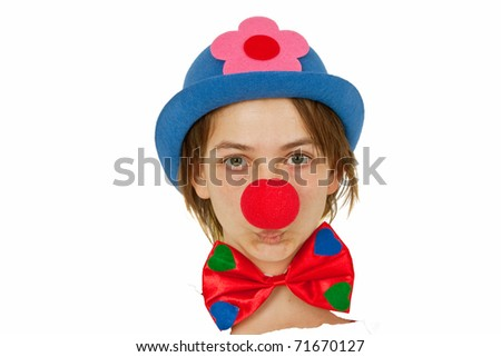 Clown with red nose looking out of white paper