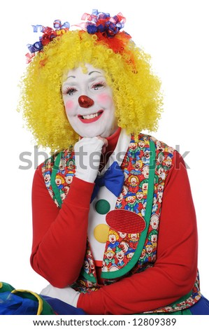 Clown with yellow hair smiling isolated over a white background - stock photo