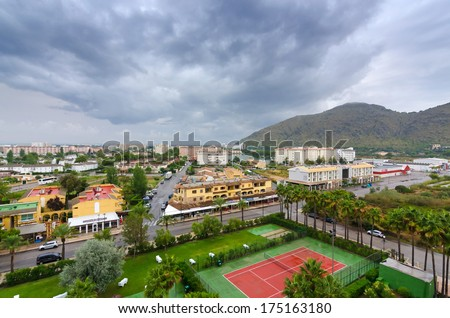 CLUB MAC HOTEL, MAJORCA-SEPTEMBER 08: Cloudy day in Alcudia city - view from Club Mac hotel in Alcudia, in September 08,2013 on Majorca. Club Mac hotel resort have 1024 air-conditioned guestrooms. - stock photo