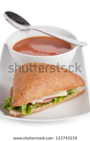 Club sandwich and tomato soup serving in a plate with spoon - stock photo
