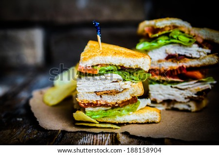 Club sandwich on rustic wooden background - stock photo