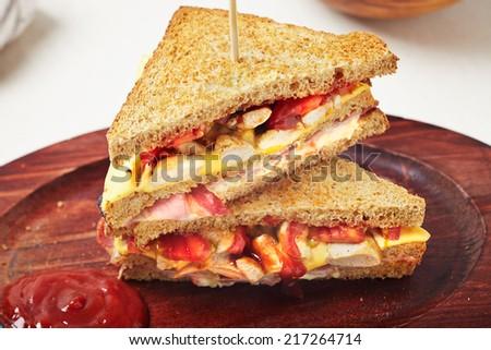 Club sandwich with salad - stock photo