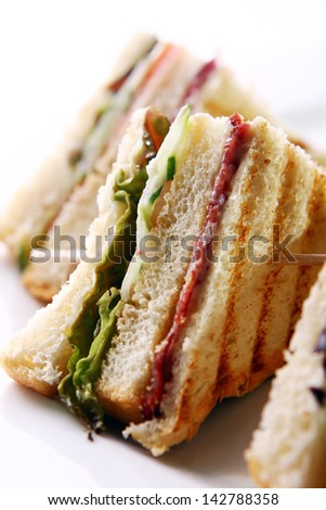 Club sandwich with salami and green