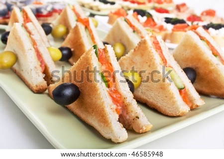 club sandwich with salmon and cucumbers on white bread - stock photo