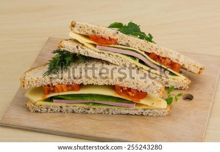 Club sandwich with sausages, tomato and cheese