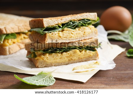club sandwich with scrambled egg and vegetables