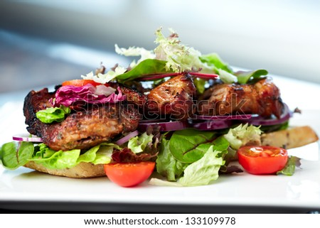 Club Sandwich with whole wheat bread baguettes, fresh salads, vegetables, brie cheese and sun-dried tomato cream - stock photo