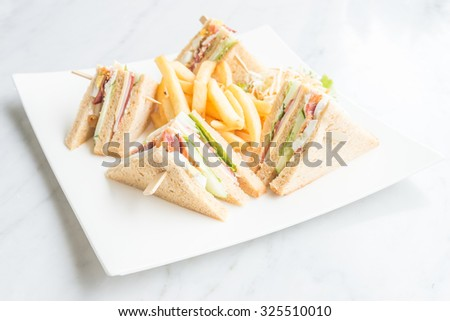Club sandwiches in white plate - selective focus point - stock photo