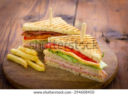 Club sandwiches on the wooden table - stock photo
