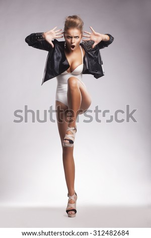 Clubbing. Eccentric Young Woman Dancing - stock photo