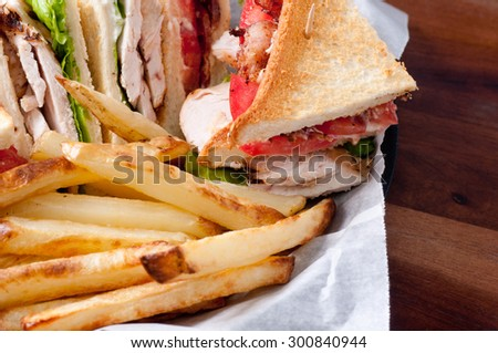 clubhouse sandwich on organic seed bread with crispy fries