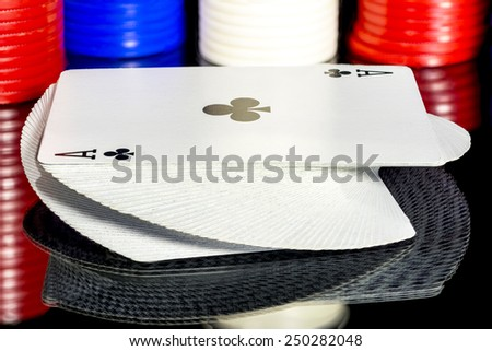 Clubs ace and chips on a table - stock photo