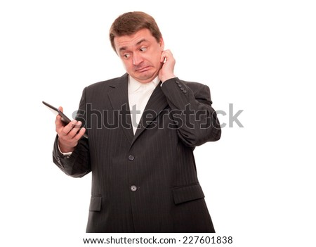 Clueless businessman looking at his tablet device. (Isolated on white.)