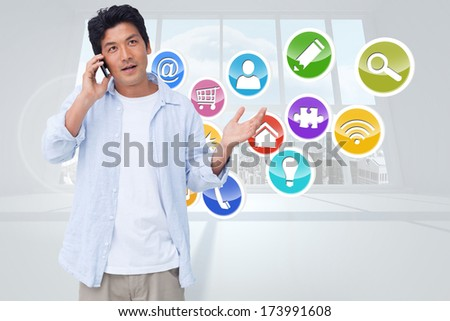 Clueless male on his cellphone against computing application icons - stock photo