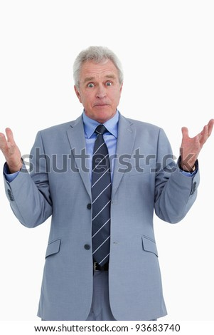 Clueless mature salesman against a white background - stock photo