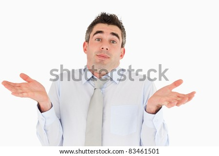Clueless office worker posing against a white background - stock photo