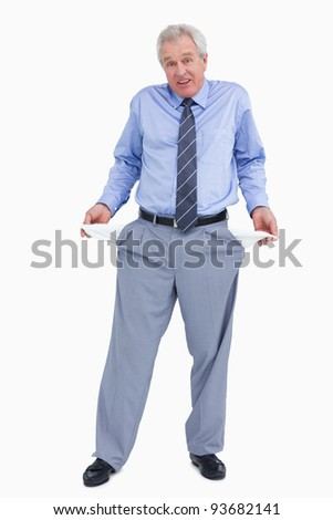 Clueless tradesman showing his empty pockets against a white background - stock photo