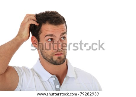 Clueless young guy. All on white background. - stock photo