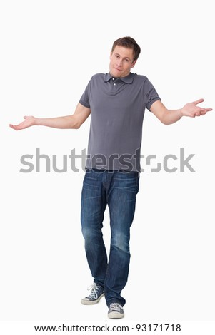 Clueless young man against a white background - stock photo