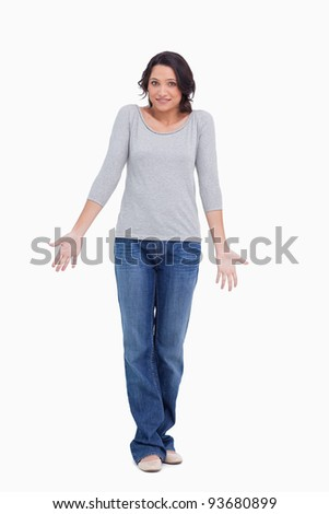 Clueless young woman against a white background - stock photo