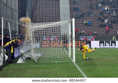 CLUJ-N, ROMANIA - NOVEMBER 5: Goalkeeper of Dinamo Buc, Balgradean C. taking a goal after a penalty at a soccer game CFR Cluj vs. Dinamo Bucharest, final score: 2-3, on Nov 5,  2011 in Cluj, Romania. - stock photo