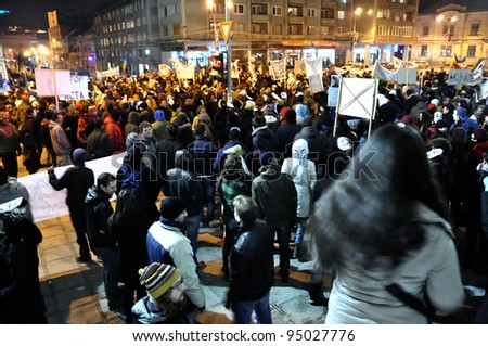 CLUJ NAPOCA – FEBRUARY 11: Hundreds of people protest against ACTA, against web piracy treaty, and the government in Cluj Napoca, on February 11, 2012 in Cluj Napoca, Romania