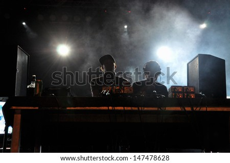 CLUJ NAPOCA - JULY 19: Camo and Krooked feat MC Youthstar from United Kingdom, performing a live concert at the Peninsula / Felsziget Music Festival. On July 19, 2013 in Cluj Napoca, Romania  - stock photo
