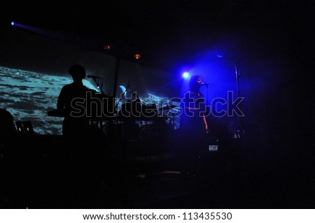 CLUJ NAPOCA - JUNE 6: Milan Fras (R), singer of group Laibach, performs live on the stage in Hotel Continental on  June 6, 2012 in Cluj, Romania