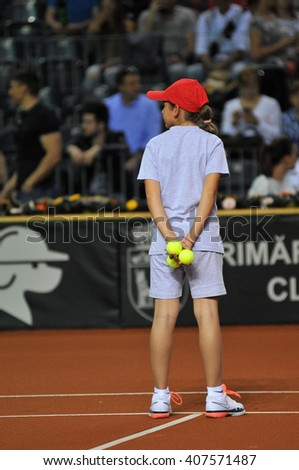 CLUJ-NAPOCA, ROMANIA - APRIL 17, 2016:  Ball girl, caddy in action during a Fed Cup tennis match, Romania against Germany