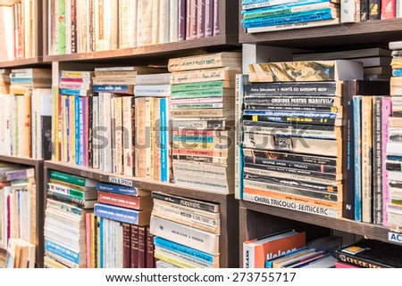 CLUJ NAPOCA, ROMANIA - APRIL 25, 2015: Bookshelf In Library With Many Old Second-Hand Books For Sale.