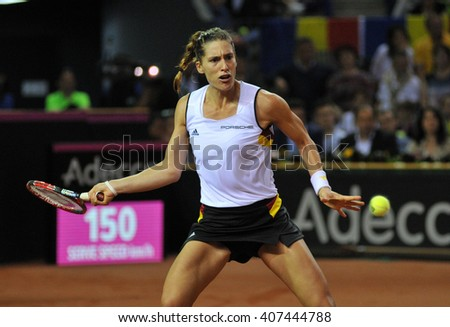 CLUJ-NAPOCA, ROMANIA - APRIL 16, 2016: German tennis player Andrea Petkovic plays against Simona Halep during a Fed Cup match in the World Cup Play-Offs Romania vs Germany