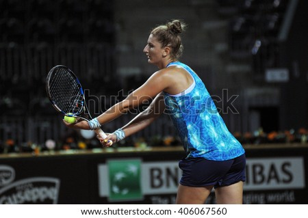 CLUJ-NAPOCA, ROMANIA - APRIL 15, 2016: Romanian tennis player Irina Begu (WTA singles ranking 35) plays during the training before the match against Germany - stock photo