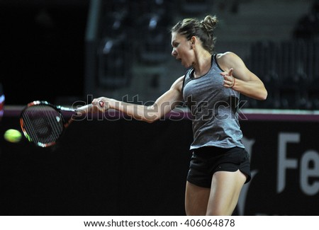 CLUJ-NAPOCA, ROMANIA - APRIL 15, 2016: Romanian tennis player Simona Halep (WTA ranking 6) plays during the training before the match against Germany - stock photo