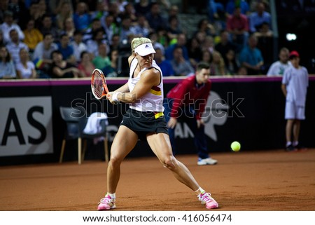 CLUJ-NAPOCA, ROMANIA - APRIL 17, 2016: Woman tennis player Angelique Kerber (WTA singles ranking 3) plays against Simona Halep during a Fed Cup match, play-offs between Romania and Germany - stock photo