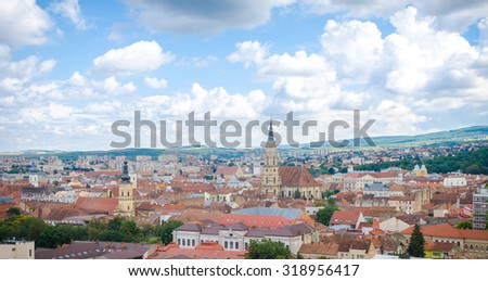 CLUJ-NAPOCA, ROMANIA - 18 AUGUST 2015: Cluj Napoca cityscape from above in the Transylvania region of Romania with the historic center, the gothic cathedral and Technical University