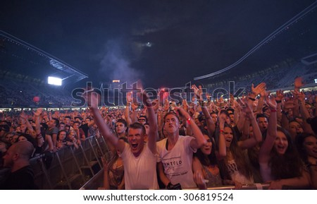 Cluj-Napoca, ROMANIA - AUGUST 3, 2015: Crowd having fun during a live concert at Untold Festival in the European Youth Capital city of Cluj Napoca - stock photo