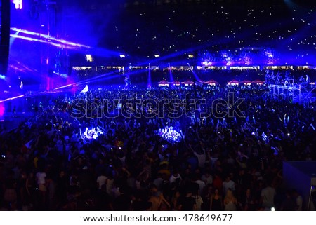 CLUJ NAPOCA, ROMANIA - AUGUST 7, 2016: Crowd of people having fun and dancing during a Dj W&W concert at Untold festival